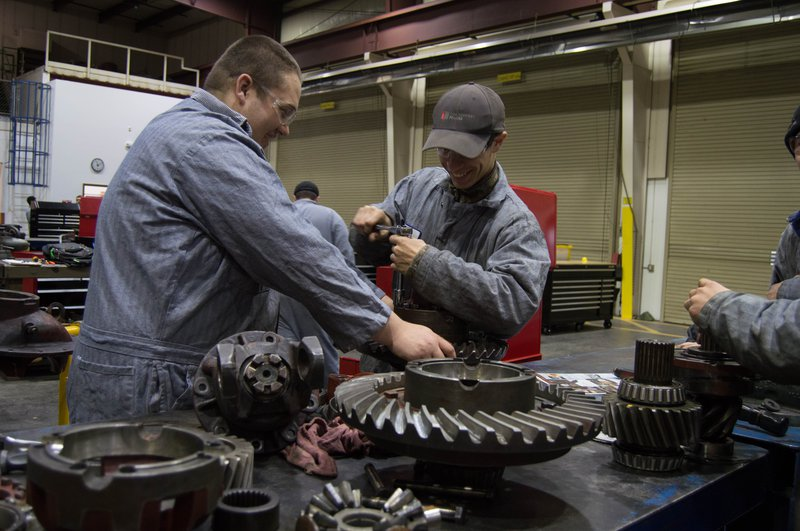 Students repair a transmission in the diesel technology shop at Centralia College.t