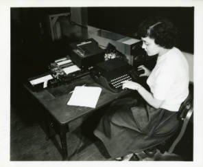 An NBS employee operating the SEAC keyboard.