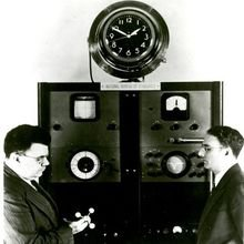 NIST Director Edward Condon (left) and clock inventor Harold Lyons with the first atomic clock.